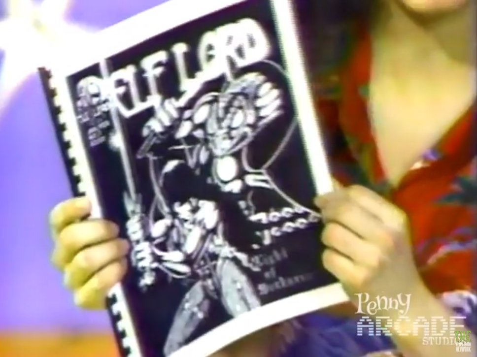 You Can't Do That on Television actor holding an issue of Elflord from the 1970s